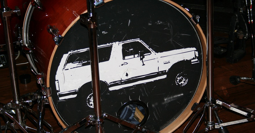 White Ford Bronco Drumset