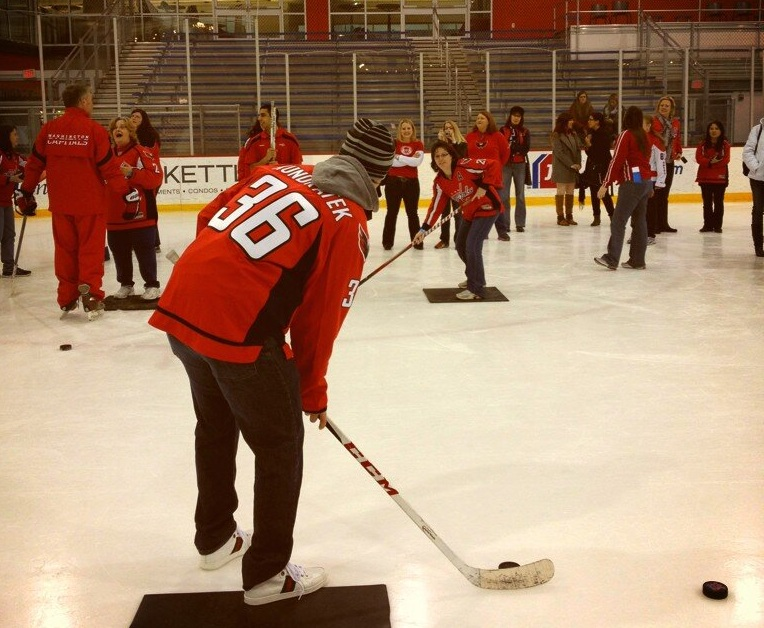 Caps player Kundratek working on passing. Photo credit: Scarlet Capitals
